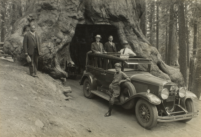 , 'George Eastman and companions riding through Wawona Tree in Yosemite National Park, Pacific Coast Trip,' 1930, George Eastman Museum