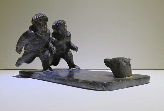 , 'Two figures running towards polar bear,' ca. 1960, Arctic Experience McNaught Gallery
