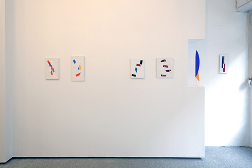 View into the exhibition- On view: paintings and a suspended object; photo: Thomas Prochnow