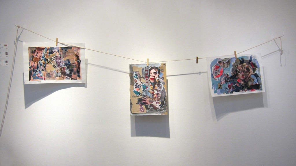 Noor Bahjat's collage on paper works pinned to a clothesline.