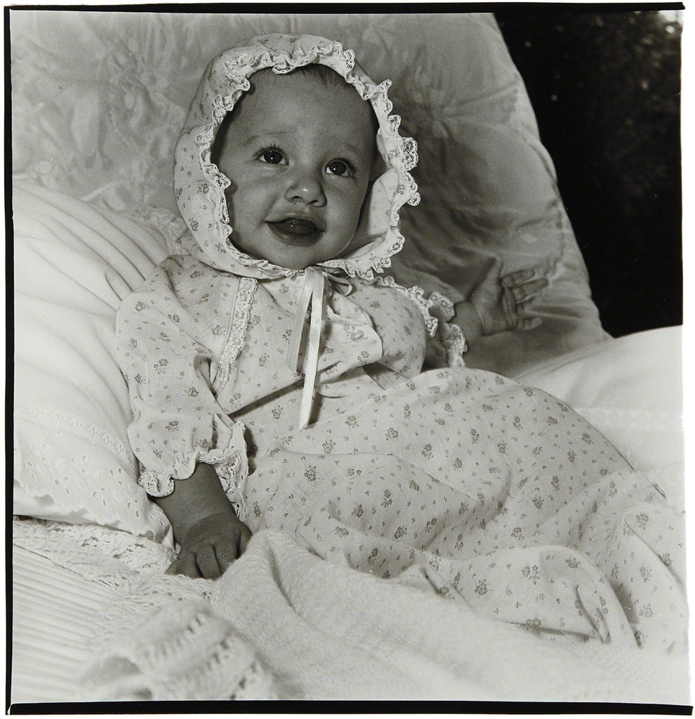 Baby in a lacey bonnet, N.Y.C.