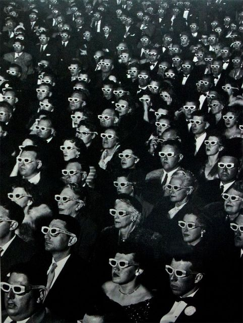 "J. R. Eyerman, 'Audience watches premiere of ""Bwana Devil"" wearing polaroid spectacles to enjoy the three dimensional sequences, Hollywood, CA', 1952, Atlas Gallery"