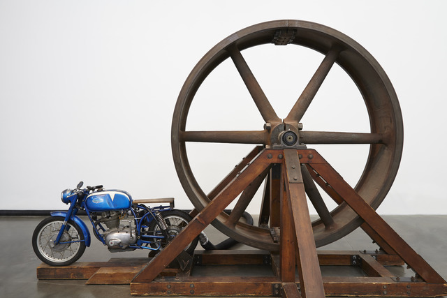 ", 'The Big Wheel. Installation view, ""Chris Burden: Extreme Measures"" at New Museum, New York, 2013,' 1979, New Museum"