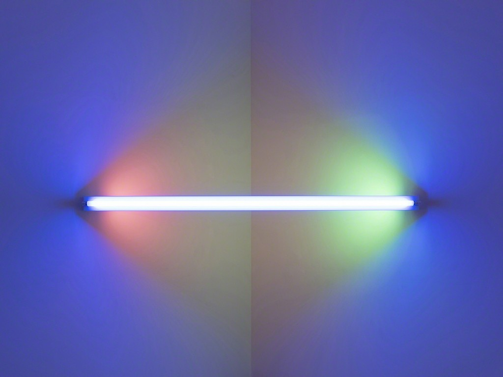 Dan Flavin,untitled (to Janie Lee) one, 1971. Blue, pink, yellow, and green fluorescent light. 8 ft. wide across a corner. Installation view:Dan Flavin: cornered fluorescent light, Mana Contemporary, Jersey City, 2018. Photo: John Berens. Courtesy of the Estate of Dan Flavin