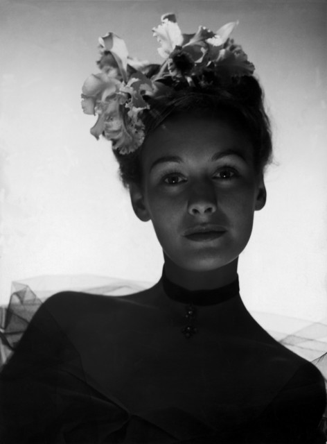 , 'SWITZERLAND. Zurich. Fashion picture. A model wearing orchids. ,' 1941, Magnum Photos
