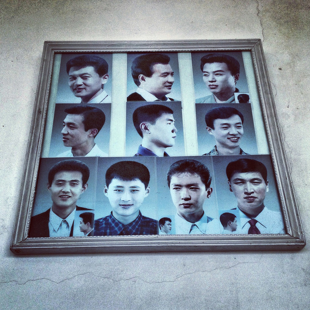 , 'Example haircuts on display at a barbershop in #Pyongyang,' 2013, Museum of Contemporary Photography (MoCP)