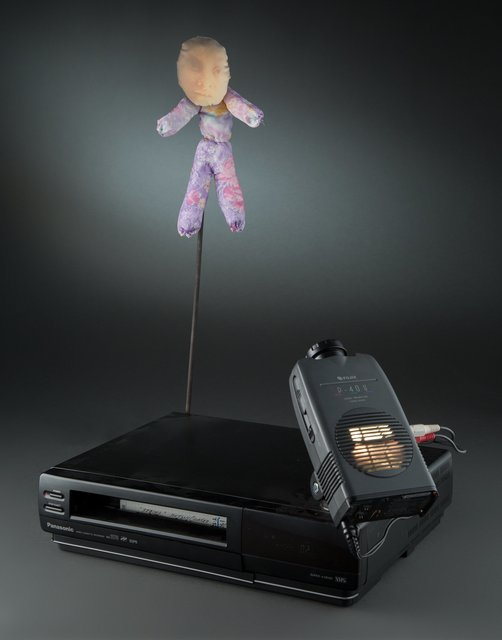 Tony Oursler, 'Untitled', Mixed Media, Projector mounted to VCR, VHS tape, doll, saftey pins, Heritage Auctions