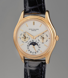 "An attractive and fine ""first series"" yellow gold perpetual calendar wristwatch with moon phase"