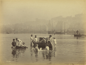 Album with 64 photographs documenting Whitby, England, including the harbor and its occupants