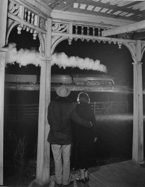 O. Winston Link, 'NW1648 Mr. & Mrs. Benjamin Pope Watch the Last Steam Passenger Train, Max Meadows, VA', December 31-1957, Robert Mann Gallery