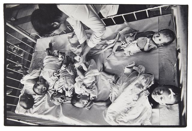 Philip Jones Griffiths, 'Orphans from the Vietnamese war in a hospital cot', c.1968, Photography, Vintage gelatin silver print, Roseberys