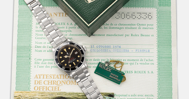 """Rolex, 'A rare and highly attractive stainless steel wristwatch with date, sweep center seconds, helium escape valve, """"Tropical, Double Red Sea-Dweller"""" dial,  bracelet, guarantee and box', 1972, Phillips"""