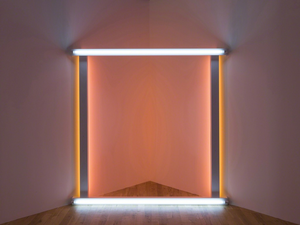 """Dan Flavin,untitled (to the """"innovator"""" of Wheeling Peachblow), 1966–68. Daylight, yellow, and pink fluorescent light. 8 ft. square across a corner. Installation view:Dan Flavin: cornered fluorescent light, Mana Contemporary, Jersey City, 2018. Photo: John Berens. Courtesy of the Estate of Dan Flavin"""