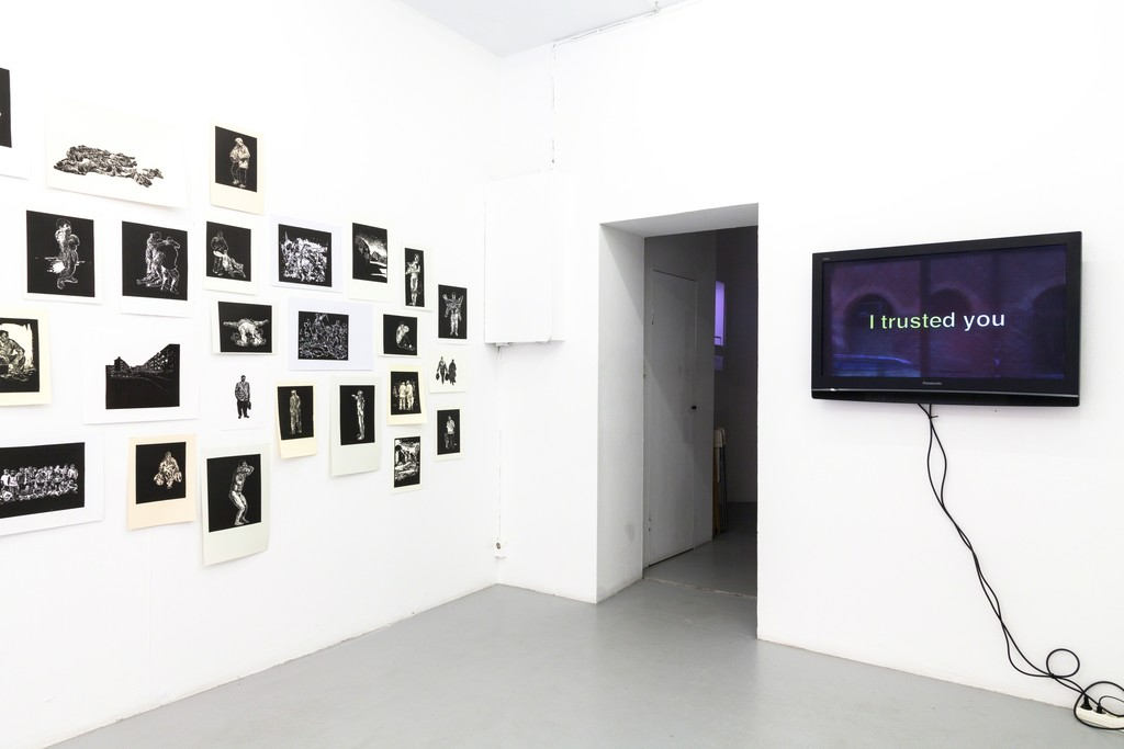 "exhibition #4: (left) Stijn Peeters (Eindhoven), Lino Cuts (2003-05) – (in the back) Luigi Archetti (Zurich), video Apodemica III (2017) – (right) Adam Knight (London), video/audio installation ""I trusted you"" (2018)"