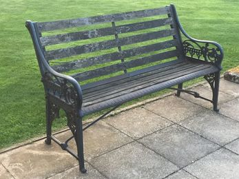 A cast iron garden bench