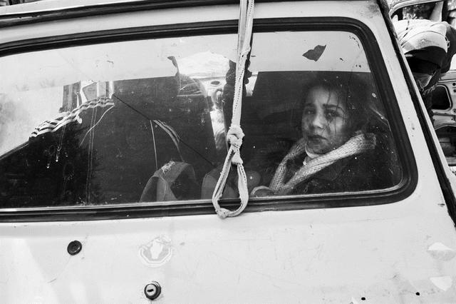 , 'Girl  through Car Window, Deir al Balah,' 2011, Q0DE