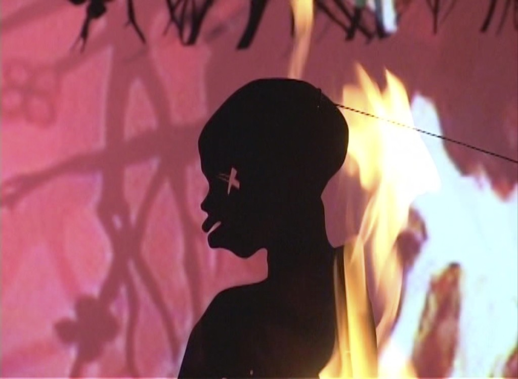 Installation view, Kara Walker, Fall Frum Grace, Miss Pipi's Blue Tale (Film Still), 2011, Video (color, sound); © Kara Walker, Courtesy Sprüth Magers and Sikkema Jenkins & Co., Photography: Timo Ohler