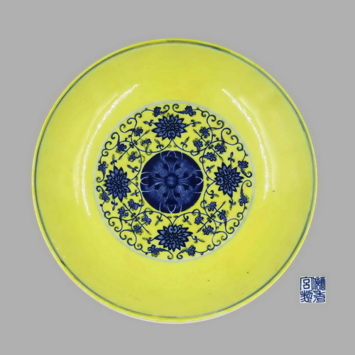 A rare yellow-ground blue and white dish with floral design.