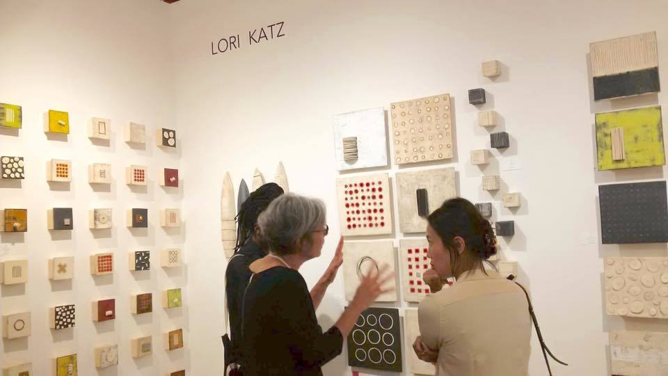 Artist Lori Katz talking to art collectors