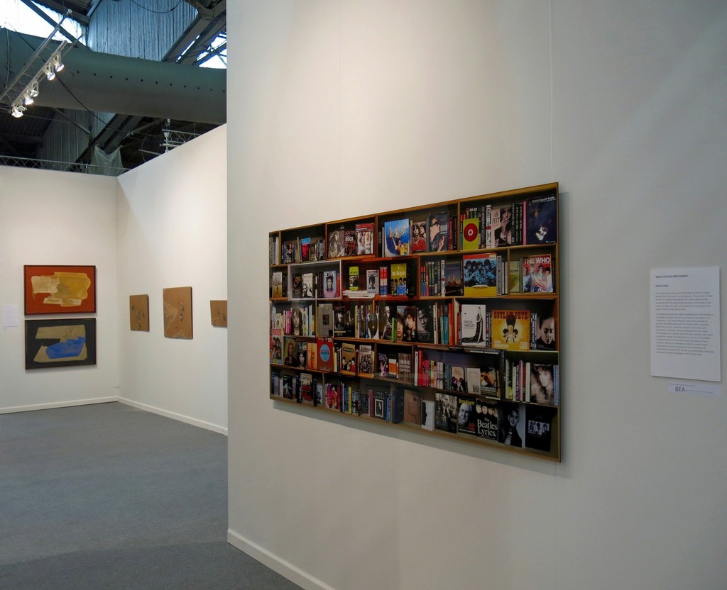 """Bookscape"" constructed photography by Max Steven Grossman. In the back, works by Santiago Uribe-Holguin and Armando Castro"