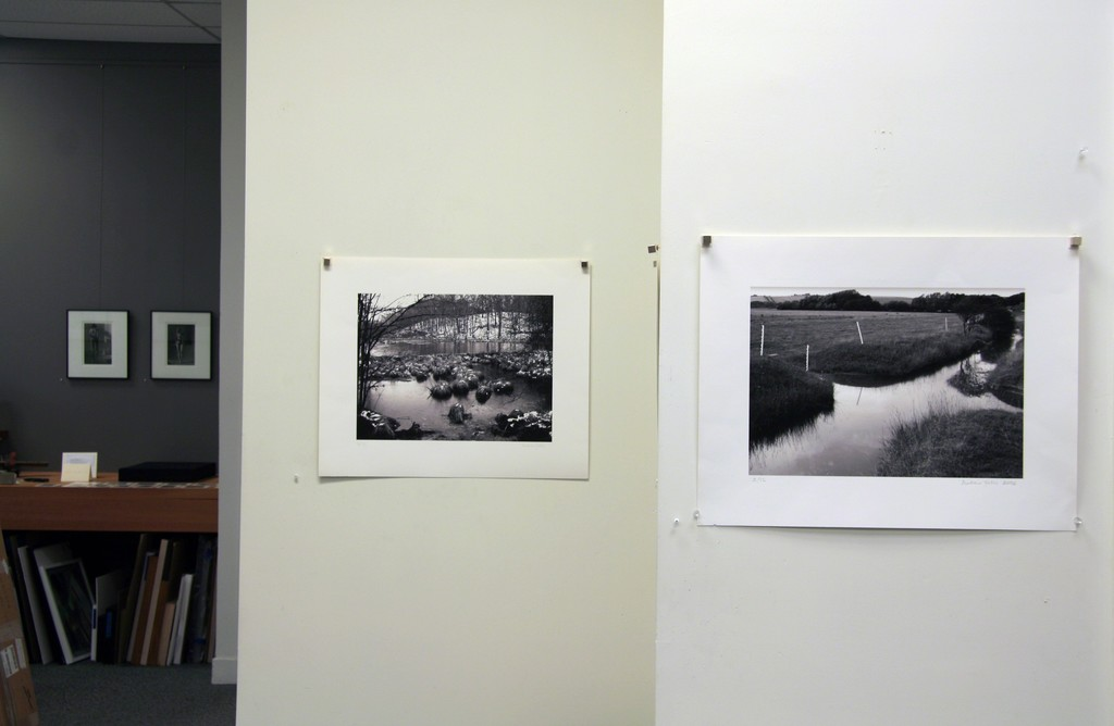 "Andrew Yates, left image: ""Snowy Lake Connecticut, Winter"", 2003, archival digital print, 12.5 x 16.5""; right image: ""Junction Drainage Streams, Cuckmere"", 2006, archival digital print ed. 2/12, 11.75 x 16.5"""