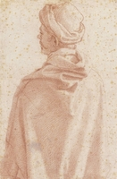 A man wearing a hat and a hooded cloak, seen from behind