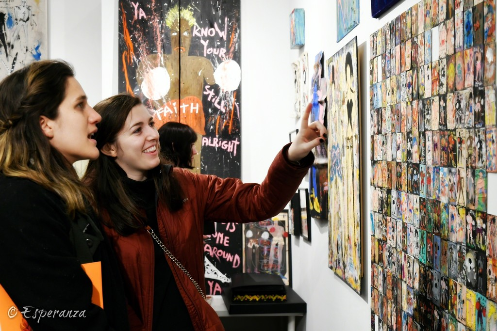 People engaged with the work of artist, Richard Kurtz • Esperanza Projects Booth 18, 2019 New York Outsider Art Fair
