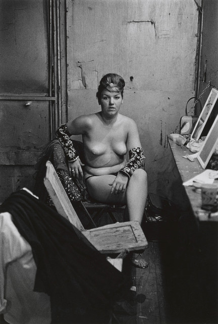 , 'Stripper with bare breasts sitting in her dressing room, Atlantic City, N.J.,' 1961, San Francisco Museum of Modern Art (SFMOMA)