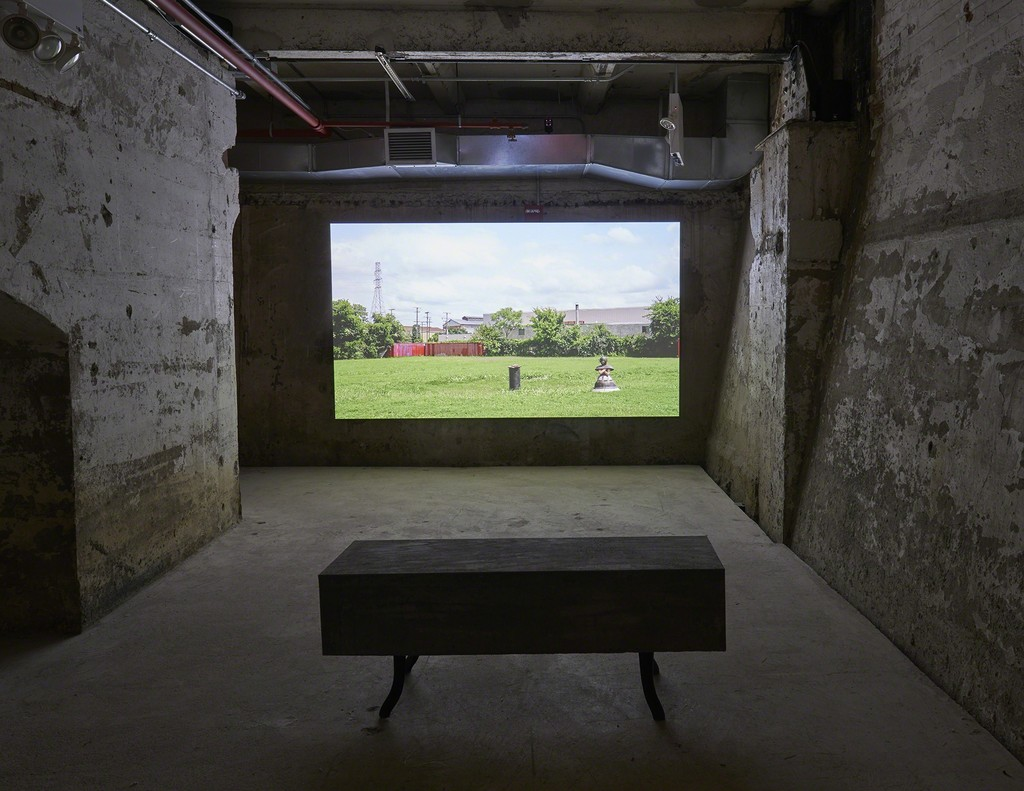 Sara Stern, COMPANY, 2018, installation view, In Practice: Other Objects, SculptureCenter, New York, 2019. HD video with color/sound, concrete and cast iron stove leg seating, weathered steel walls, credits video. Dimensions variable. Video: 13:00 minutes (looped). Sound mix by Gisburg. Courtesy the artist. Photo: Kyle Knodell