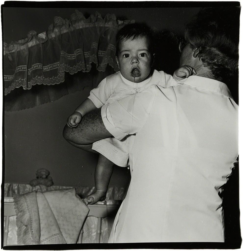 Toddler being held by nurse, N.J.
