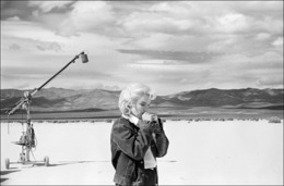 ", 'US actress Marilyn Monroe on the Nevada desert going over her lines for a difficult scene she is about to play with Clarke Gable in the film ""The Misfits"" by John Huston (Nevada),' 1960, Magnum Photos"