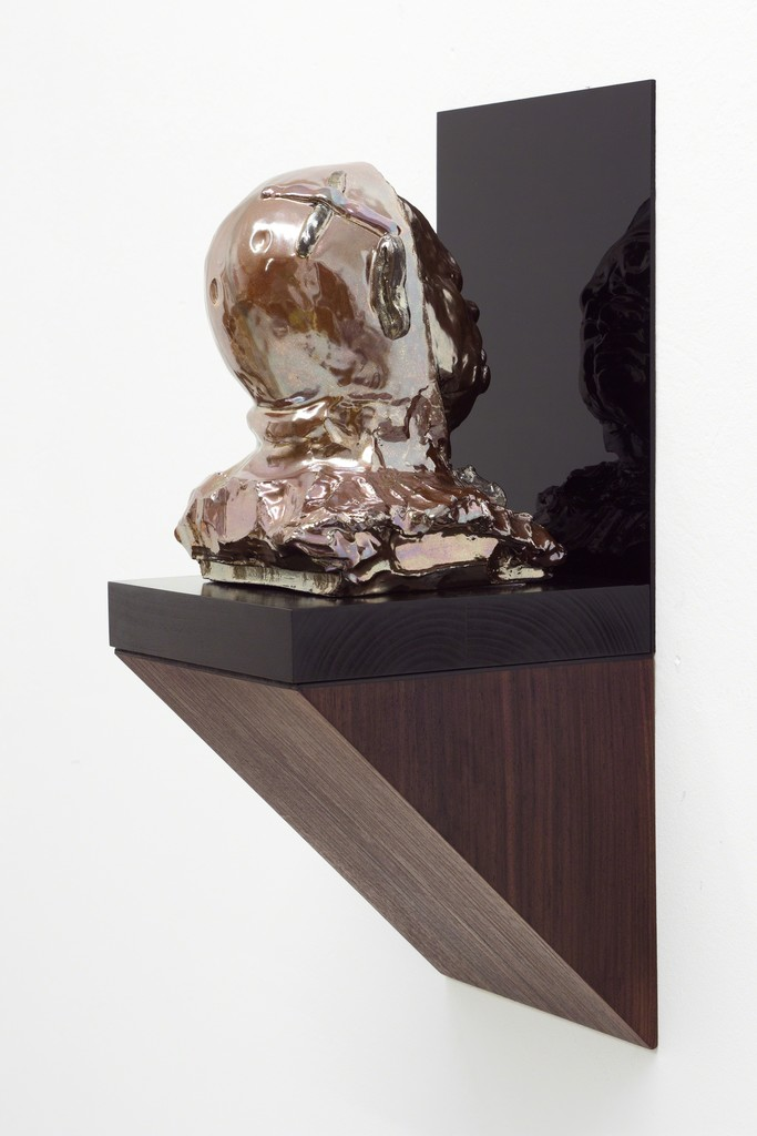 Sebastian Neeb, An intelligent man is sometimes forced to get drunk to pass the time between the idiots, 2013, Glazed ceramic on ebonised wood base, rosewood veneered wall console, Perspex, 60 x 25 x 26 cm (Ceramics ø 26 cm)