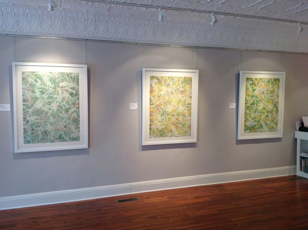 Dark Green Marathon, Yellow Marathon and Light Green Marathon on display, all by Sam Gilliam