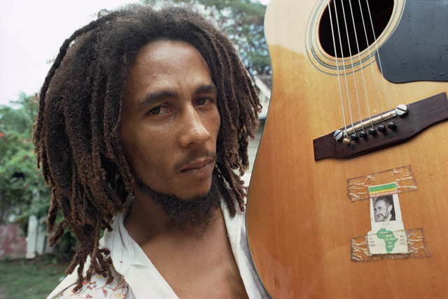, 'Bob Marley with his guitar, decorated with a picture of Haile Selassie at his home, Tuff Gong, Kingston, Jamaica,' 1976, Anastasia Photo