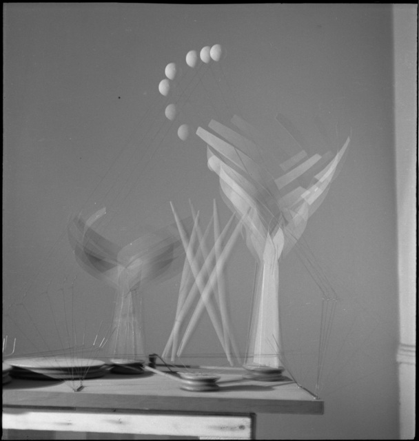 ", 'Dancers and Sphere (maquette for 1939 New York World's Fair) set in motion in Calder's ""small shop"" New York City storefront studio,' 1938, Whitney Museum of American Art"