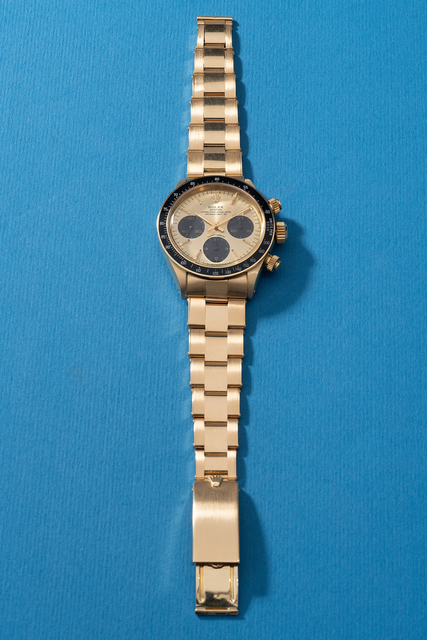 Rolex, 'A highly attractive and very rare yellow gold chronograph wristwatch with bracelet, original guarantee, hang tag and presentation box', Circa 1985, Phillips