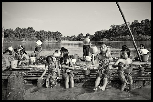 , 'Bath time - Children in a boarding school along the lower Baram River bathe before dinner,' 2015, SCShekar