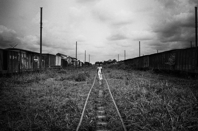 , 'Woman walking by train tracks,' 2011, °CLAIR Galerie