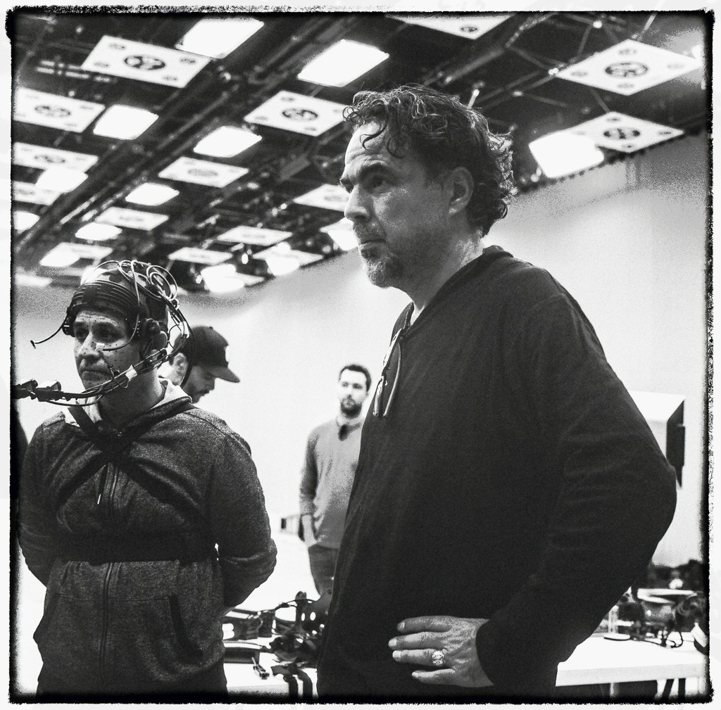 Alejandro G. Iñárritu and a baker from El Salvador at a motion capture shoot for Carne y Arena.