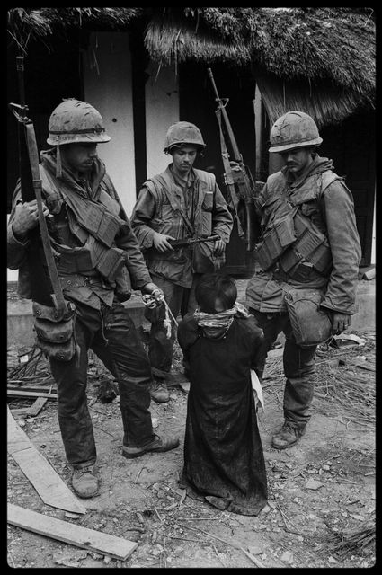 , 'US Soldiers tormenting a civilian in the old city of Hue during the offensive, Tet, Hue,' 1968, Hamiltons Gallery