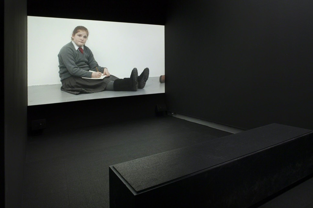 Installation shot of Rineke Dijkstra's Ruth Drawing Picasso, Tate Liverpool, UK, 2009. 1 channel HD video. Photo from the exhibition 'Fire under Snow: New film and video works at Louisiana', 27.1.-8.5.2016, Louisiana Museum of Modern Art.
