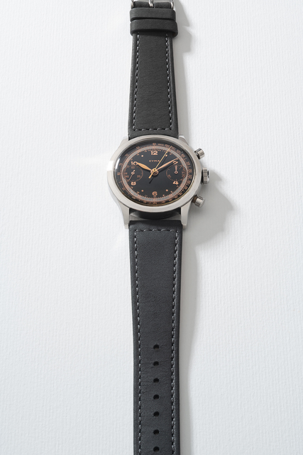 Cyman, 'A very rare stainless steel chronograph wristwatch with glossy black dial, telemeter and tachymeter scales', Circa 1950s, Phillips