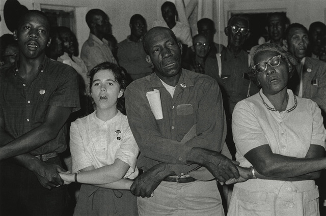 """Bob Adelman, '""""In West Feliciana, an overwhelmingly black parish where no person of color had voted in the twentieth century, volunteer Mimi Feingold urged members of a church congregation to try to vote. She then joined hands with them to sing, 'This Little Light of Mi""""', 1963, Photography, Gelatin silver print; printed later, Howard Greenberg Gallery"""