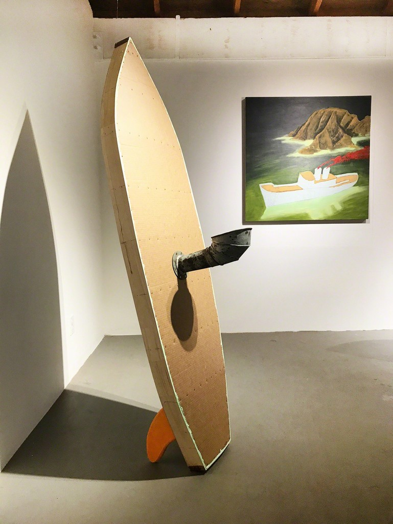 Featured exhibition works by Doug Britt (left to right): Twin Fin Surfer 2017 mixed media 45 x 43 x 11 inches, Uncharted Waters 2017 acrylic on panel 38 x 38 inches.