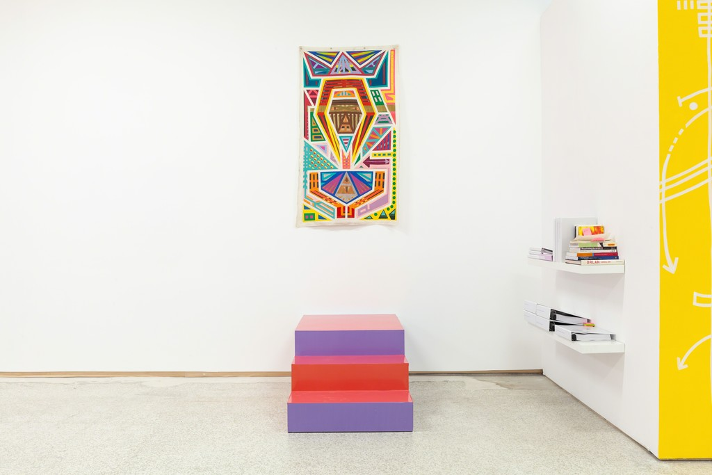 Installation view of Marcus Blake's First Queen (Quantum Kente Series), 2018. Germane Barnes and Karen Rifas' (section) Exploding Staircase, 2018 and Paradise Commons Library.