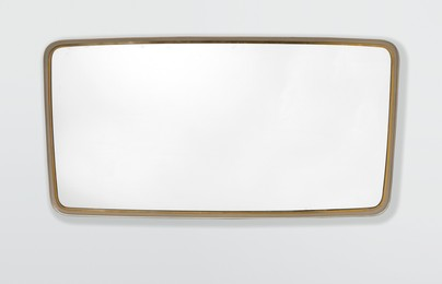 a mirror with a brass frame