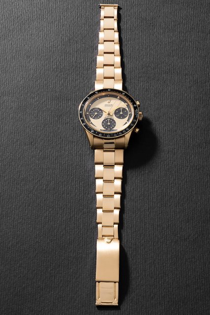 """Rolex, 'An extremely rare, beautiful and well-preserved yellow gold chronograph wristwatch with champagne """"Paul Newman"""" dial, bracelet and box', Circa 1968, Phillips"""