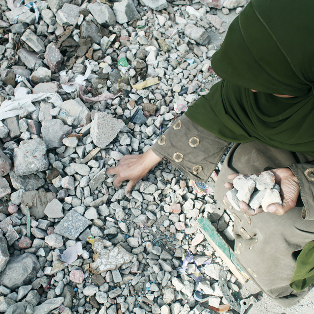 , 'Egypt's Revolution, A woman collects rocks and keep on repeating she will not go until Moubarak goes. Cairo, Egypt,' 2011, Fort Worth Contemporary Arts
