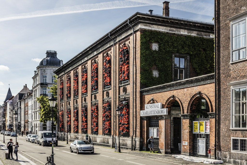 "Ai Weiwei, ""Soleil Levant"", 2017. Installation view, Kunsthal Charlottenborg, 2017. Life jackets in front of windows of facade. Courtesy of the artist. Photo by Anders Sune Berg."