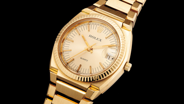 Rolex, 'A fine and very heavy yellow gold wristwatch with center seconds, date, bracelet and presentation box', Circa 1970, Phillips